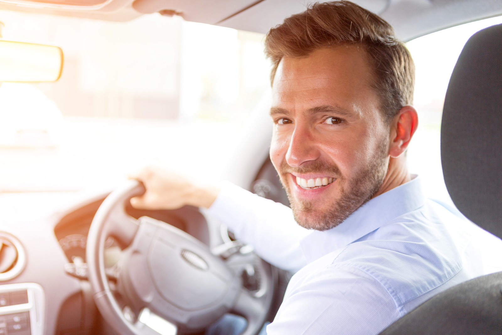 Man driving away his new car with the best car finance deal