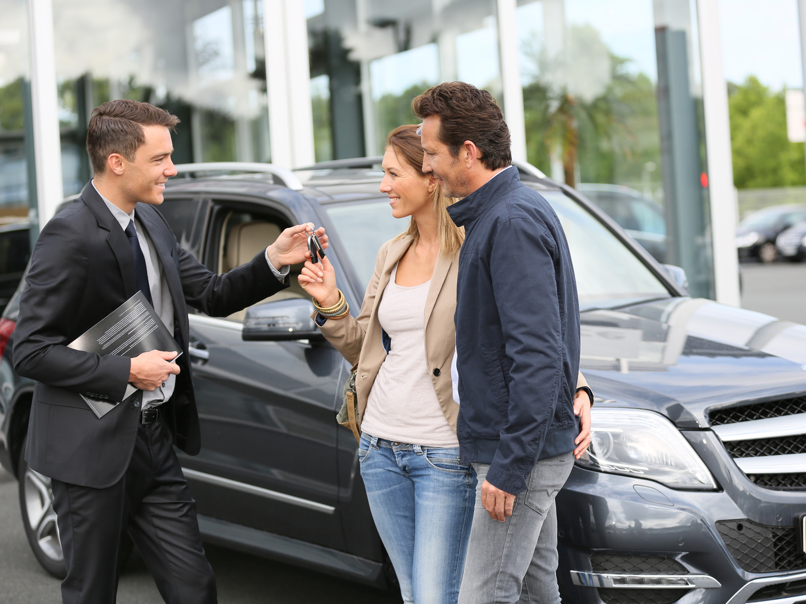 Couple buying their used car on finance