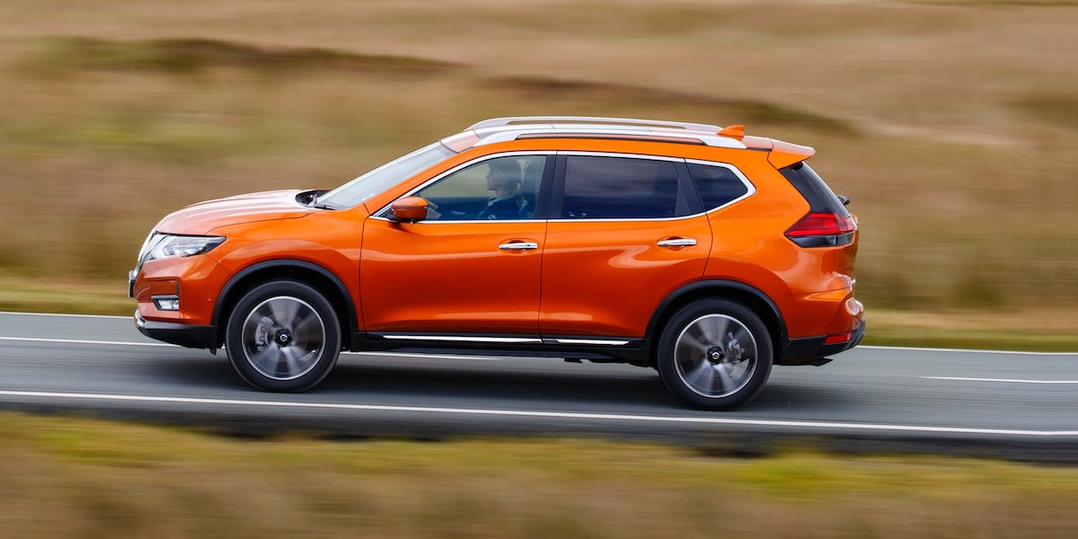 Orange Nissan X Trail