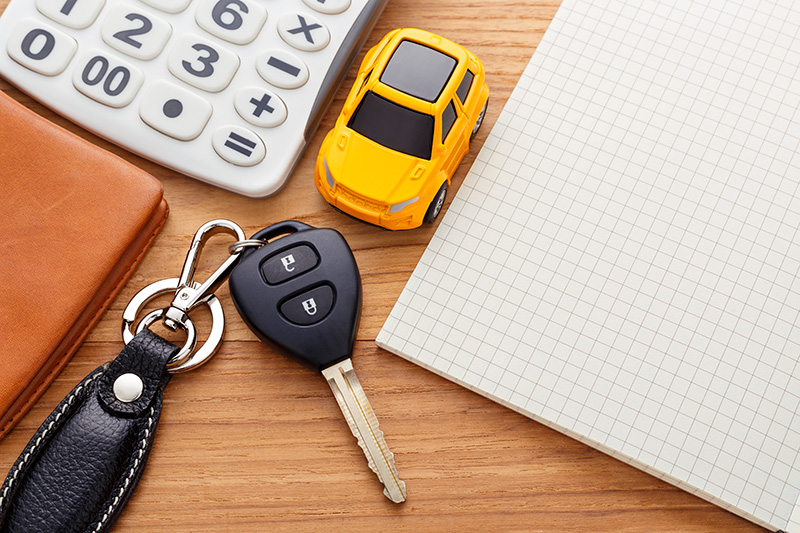 Car keys and wallet on table