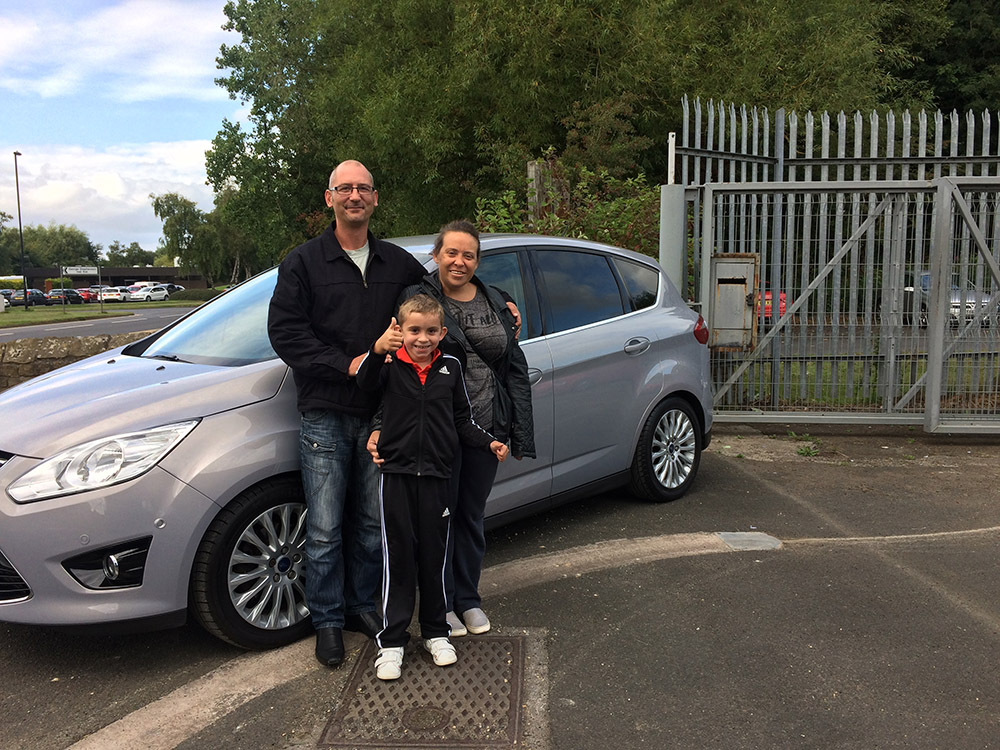 Happy family with their new car